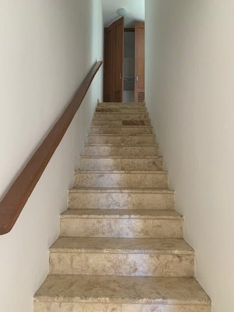 palma real condominium stairs and unit entrance